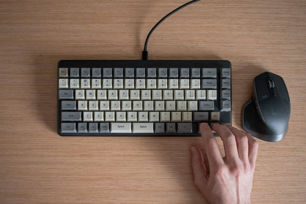 The mouse, in very close proximity to someone's right hand on the arrow keys.