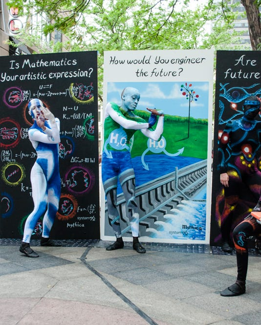 Painted Engineering dancer freestyle dancing in front of the 'How you woud engineer the future?' panel